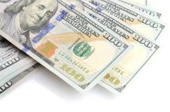 100 долларов бумажных денег изолированных на белизне Стоковое фото RF