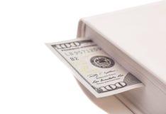 100 долларов в книге Стоковая Фотография