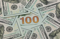 100 долларов в круге Стоковая Фотография