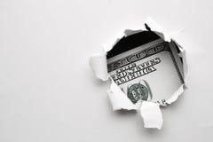 100 долларов в отверстии бумаги Стоковая Фотография