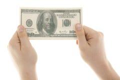 100 долларов в руке Стоковая Фотография