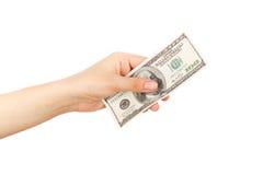 100 долларов в ` s женщины вручают, изолированный Стоковая Фотография