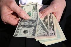 доллары предпосылки изолировали нас белые стоковые фото