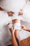 Одевать невесту Стоковые Фотографии RF