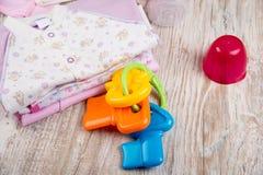 Одежды младенца для девушки Стоковое Изображение