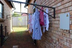 Одежды повешенные на моя линии Стоковое фото RF