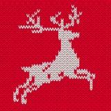 Олени на картине свитера безшовной Стоковая Фотография