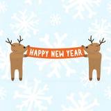 2 оленя шаржа держа счастливый знак Нового Года Стоковое фото RF