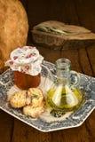 Оливковое масло, хлеб и законсервированный натюрморт томатов Стоковая Фотография RF
