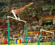 Олимпийские желчи Simone чемпиона Соединенных Штатов состязаются на неровных барах на команде женщин все-вокруг гимнастики на Рио Стоковое Изображение