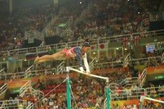 Олимпийские желчи Simone чемпиона Соединенных Штатов состязаются на неровных барах на команде женщин все-вокруг гимнастики на Рио Стоковые Фото