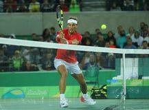 Олимпийский чемпион Рафаэль Nadal Испании в действии во время выпускных экзаменов двойников людей Рио 2016 Олимпийских Игр Стоковые Фотографии RF