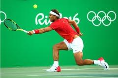 Олимпийский чемпион Рафаэль Nadal Испании в действии во время людей определяет четвертьфинал Рио 2016 Олимпийских Игр Стоковая Фотография