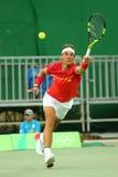 Олимпийский чемпион Рафаэль Nadal Испании в действии во время людей определяет первую спичку круга Рио 2016 Олимпийских Игр Стоковая Фотография