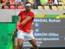 Олимпийский чемпион Рафаэль Nadal Испании в действии во время ` s людей определяет спичку полуфинала Рио 2016 Олимпийских Игр Стоковые Фото
