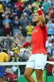 Олимпийский чемпион Рафаэль Nadal Испании празднует победу после того как люди определяют четвертьфинал Рио 2016 Олимпийских Игр Стоковые Фотографии RF
