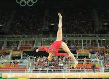Олимпийский чемпион Aly Raisman Соединенных Штатов состязается на коромысле на ` s женщин все-вокруг гимнастики на Рио 2016 Олимп Стоковые Фотографии RF