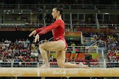 Олимпийский чемпион Aly Raisman Соединенных Штатов состязается на коромысле на ` s женщин все-вокруг гимнастики на Рио 2016 Олимп Стоковая Фотография