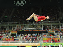 Олимпийский чемпион Aly Raisman Соединенных Штатов состязается на коромысле на ` s женщин все-вокруг гимнастики на Рио 2016 Олимп Стоковые Изображения