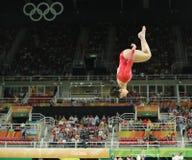 Олимпийский чемпион Aly Raisman Соединенных Штатов состязается на коромысле на ` s женщин все-вокруг гимнастики на Рио 2016 Олимп Стоковое фото RF