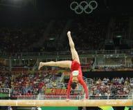 Олимпийский чемпион Aly Raisman Соединенных Штатов состязается на коромысле на ` s женщин все-вокруг гимнастики на Рио 2016 Олимп Стоковое Фото