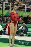 Олимпийский чемпион Aly Raisman Соединенных Штатов состязаясь на коромысле на ` s женщин все-вокруг гимнастики на Рио 2016 Олимпи Стоковое Фото