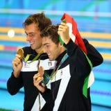 Олимпийский чемпион Gregorio Paltrinieri l и Gabriele Detti Италии во время представления медали на ` s людей фристайл 1500 метро Стоковые Изображения RF