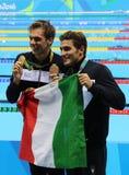 Олимпийский чемпион Gregorio Paltrinieri l и Gabriele Detti Италии во время представления медали на ` s людей фристайл 1500 метро Стоковая Фотография RF