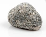 Одиночный камень изолированный на белой предпосылке Стоковое фото RF