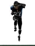 Силуэт американского человека футболиста идущий Стоковое фото RF