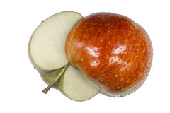 Один отрезок яблока в половины с черенок и ямой Стоковая Фотография RF