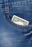 Один доллар получает внутри карманн наличными джинсов Стоковое Фото