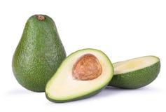 Один 2 половин авокадо всех и Стоковое Изображение