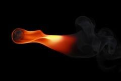 один файрбол при дым изолированный на черноте стоковая фотография