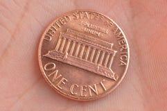 Один цент в руке Стоковые Фото