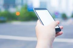 Один люд используя один умный телефон Стоковые Фото
