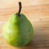 Одна зеленая груша Стоковые Фото