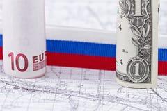 Одн-доллар, 10 счетов евро и компас Стоковые Изображения