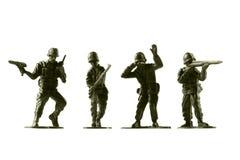 Оловянные солдатики, изолированные на белой предпосылке Стоковая Фотография RF