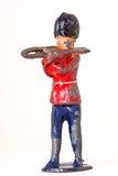 Оловянный солдатик с тромбоном - взглядом угла стоковое фото