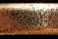 падает золотистая вода металла Стоковые Фотографии RF