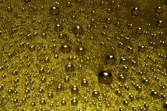 падает золотистая вода Стоковые Фотографии RF