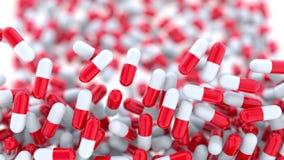 Падающ красные и белые капсулы или пилюльки лекарства, отмелый фокус перевод 3d Стоковые Фотографии RF