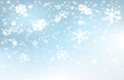 Падая снег на свете - голубая предпосылка Стоковая Фотография