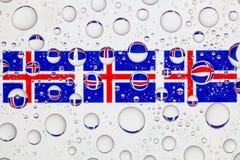 Падения воды на стекле и флаге Исландии Стоковое Фото