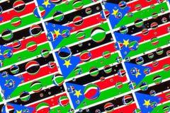 Падения дождя вполне южных флагов Судана стоковые фото