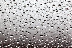 Падения дождя на стекле, предпосылке textu предпосылки падения воды Стоковое Фото