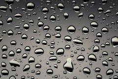 Падения дождя на стекле, предпосылке textu предпосылки падения воды Стоковое Изображение