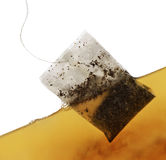 Пакетик чая в воде стоковые фото
