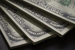 Пакеты американца миллион долларов бумажных денег в конце вверх по взгляду Стоковые Фотографии RF